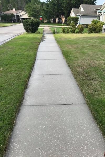 HeatWave Pressure Washing - HOA - Sidewalk clean